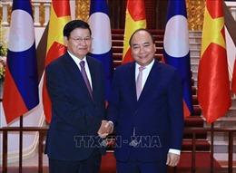 WEF ASEAN 2018: Thủ tướng Nguyễn Xuân Phúc tiếp Thủ tướng Lào