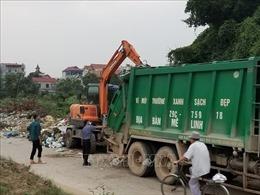 Đã xử lý dứt điểm khu vực tập kết rác tại đê tả sông Hồng đoạn qua thôn Hạ Lôi