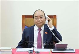 Thủ tướng Nguyễn Xuân Phúc điện đàm với Thủ tướng Lào Thongloun Sisoulith