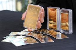 Giá vàng châu Á xuống mức thấp nhất trong một tuần