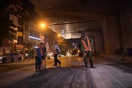 Xuyên đêm cải tạo, sửa chữa mặt đường Nguyễn Trãi (Hà Nội)