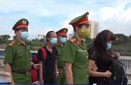 Bàn giao 2 đối tượng tổ chức xuất cảnh trái phép cho Trung Quốc