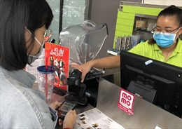 Ví MoMo khuyến cáo hạn chế sử dụng tiền mặt để bảo vệ chính mình và cộng đồng