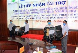 Tiếp nhận tài trợ 700 túi chứa nước cho nông dân Vĩnh Long bị ảnh hưởng hạn, mặn
