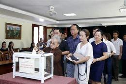 Nghĩa tình người Việt tại Lào với đồng bào miền Trung