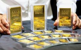 Giá vàng thế giới phiên 22/10 đi xuống trước sự mạnh lên của đồng USD