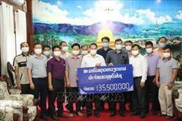 Cộng đồng người Việt ở Bắc Lào chung tay hỗ trợ chính quyền khống chế dịch