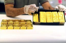 Chiều 6/10, đà tăng của đồng USD gây sức ép lên giá vàng châu Á