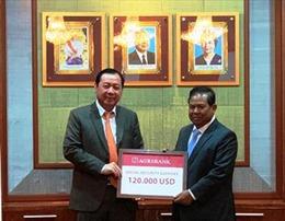 Tổng Giám đốc Agribank tham gia Hội nghị về kết quả đầu tư trồng cây cao su tại Campuchia