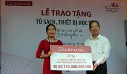 Agribank Bến Tre: Trao tặng tủ sách, thiết bị học tập tại trường THCS Hưng Lễ