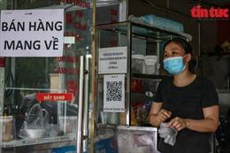 Hà Nội: Quán ăn mở cửa dè chừng sau lệnh nới lỏng, có nơi chưa dán mã QR Code