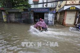 Hà Nội khẩn trương khắc phục úng ngập tại đường Lê Trọng Tấn