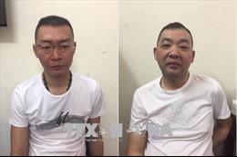 Bàn giao hai đối tượng truy nã cho Công an Trung Quốc