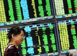 Đồng USD rớt giá, chứng khoán châu Á khởi sắc sau cuộc họp của Fed