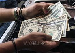 Căng thẳng Mỹ - Trung tác động mạnh tới thị trường ngoại hối, chứng khoán trong nước