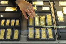 Giá vàng thế giới giảm lần đầu tiên trong 11 phiên