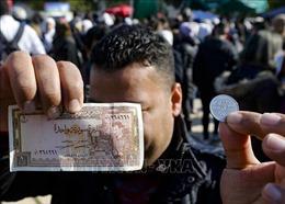 Syria hạ giá đồng nội tệ