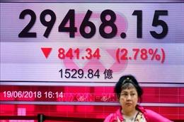 Chứng khoán châu Á đi xuống sau khi vòng áp thuế mới Mỹ-Trung có hiệu lực