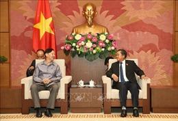 Phó Chủ tịch Quốc hội Đỗ Bá Tỵ tiếp Đoàn đại biểu Viện Nghiện cứu pháp luật Quốc hội Lào
