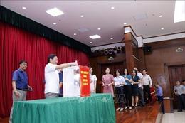 Cộng đồng người Việt tại Lào giúp người dân địa phương khắc phục thiên tai
