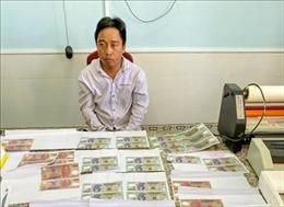 Bắt tạm giam hai bị can sản xuất, tàng trữ tiền giả