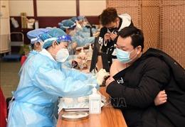 Trung Quốc ghi nhận số ca mắc COVID-19 thấp nhất trong 1 tháng