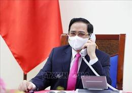 Thủ tướng Phạm Minh Chính điện đàm với Thủ tướng Nhật Bản Suga Yoshihide