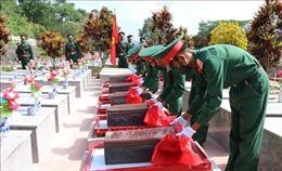 An táng hài cốt 9 liệt sĩ quân tình nguyện và chuyên gia hy sinh tại Nam Lào