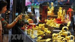 Giá vàng châu Á lấy lại đà tăng, chứng khoán đồng loạt đi xuống