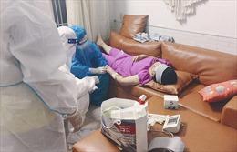 Theo chân các chiến sĩ quân y khám bệnh cho F0 tại nhà ở TP Hồ Chí Minh