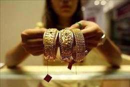 Giá vàng thế giới giảm xuống mức thấp nhất trong một tuần