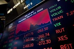 Chứng khoán Mỹ giảm mạnh sau động thái hạ lãi suất của FED