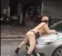 Truy bắt lái xe taxi hất cảnh sát giao thông lên nắp capô rồi bỏ chạy