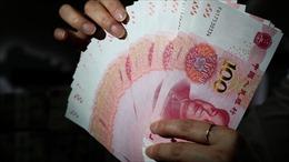 Thực hư việc Trung Quốc in ngoại tệ quy mô lớn