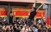 Tục giằng bông tại lễ hội Sơn Đồng