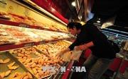 Trung Quốc muốn tăng nhập khẩu, các công ty tỏ vẻ dè dặt