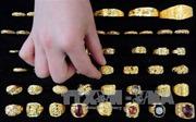 Giá vàng tại châu Á giảm xuống mức thấp trong hơn hai tuần