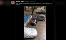 Hố tử thần đầy nước 'nuốt chửng' ô tô đang đỗ chỉ trong tích tắc